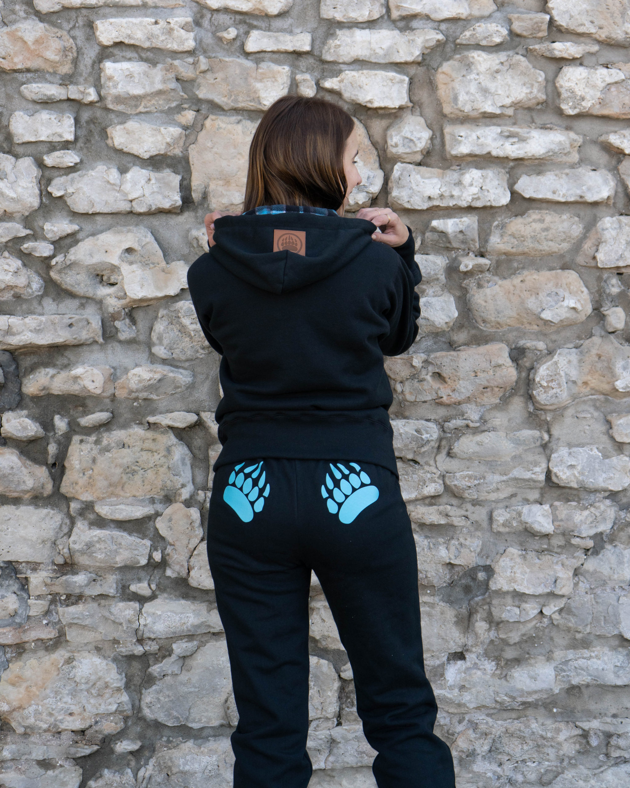 Content Creator Em wearing the Black with Aqua Ladies Cabin Hoody and Original Paw Pants