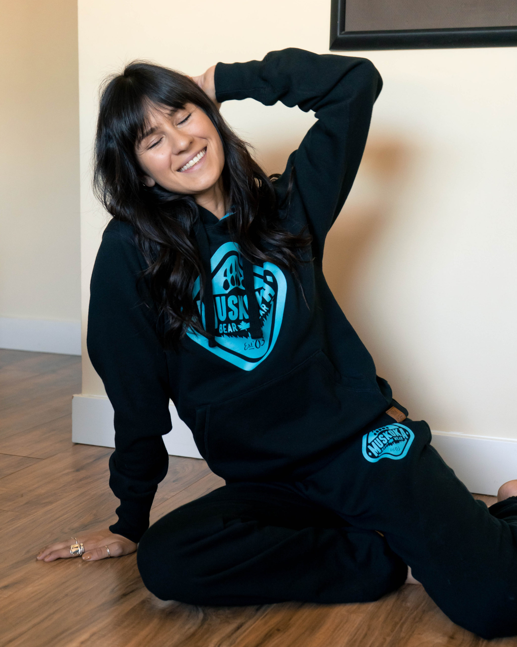 Content Creator Mal.Bee wearing the Black with Aqua Ladies Cabin Hoody and Original Paw Pants